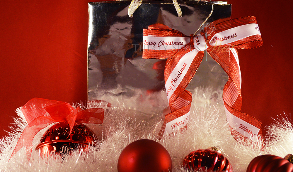 Ideas for gift wrapping using a gift bag and personalized custom ribbon with logo.