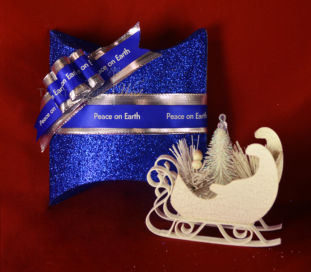 Customize your Merry Christmas ribbon with a logo or message in blue and silver for an elegant statement. Create a personalized ribbon they will want to keep as memories of a special occasion or holiday.  Add a sleigh ornament for even more fun.